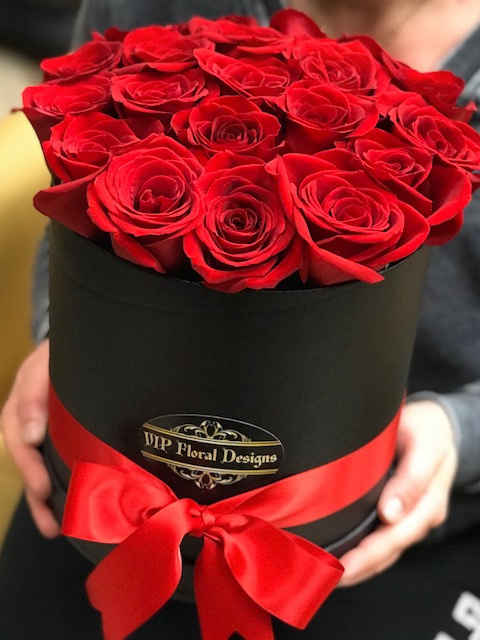 hat flower box with red roses